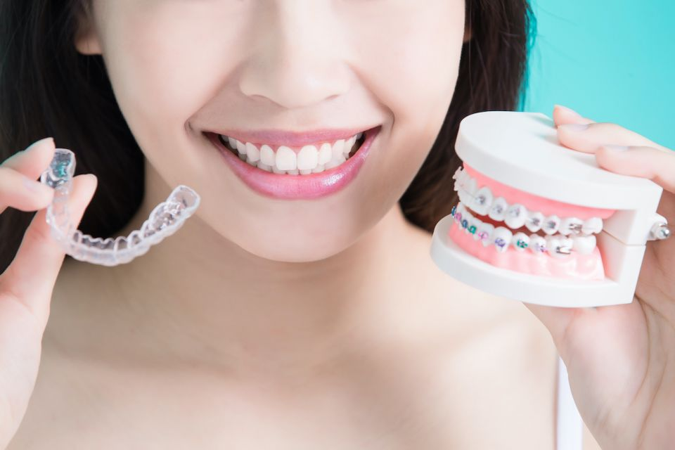 Are Metal Houston Braces Better Than Invisalign Clear Aligners?